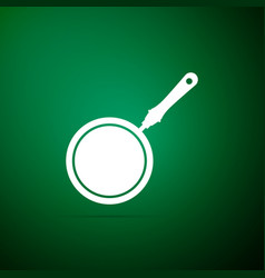 Frying pan icon isolated on green background vector