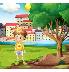 A boy with rubber duck above his head standing vector