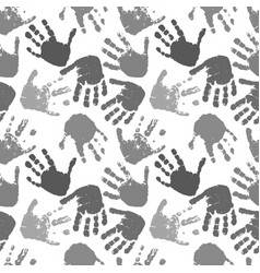 seamless pattern of prints of hands vector image