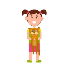 Little girl with ponytails stands and holds cat vector