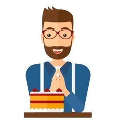 Man looking at cake vector image
