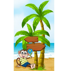 A beach with a smiling monkey sitting under the vector image vector image