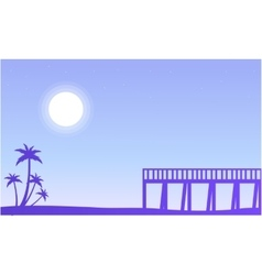 Silhouette of pier and palm scenery vector