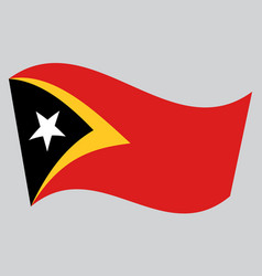 flag of east timor waving on gray background vector image