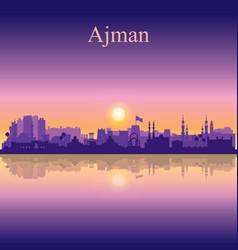 Ajman silhouette on sunset background vector