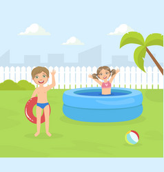 Boy and girl playing in inflatable pool in the vector