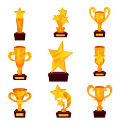 golden awards set trophy cups and awards in shape vector image vector image