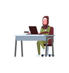 arab female doctor using laptop at workplace desk vector image