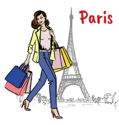 Woman with shopping bags in paris vector