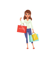 beautiful brunette woman holding shopping bags vector image