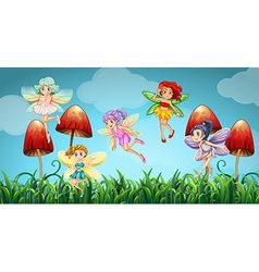 Fairies flying in the mushroom garden vector