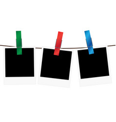 three blank polaroid frames hanging on a rope vector image