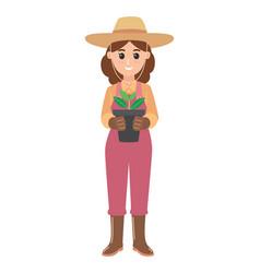 Gardeners stand holding a flower pot vector