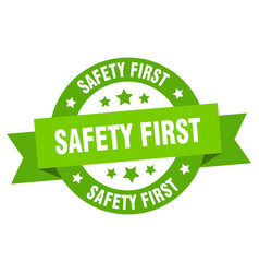 safety first ribbon safety first round green sign vector image