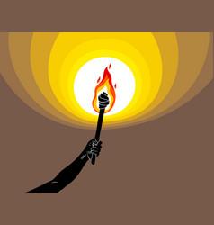 Torch in a hand raised up illuminates dark vector