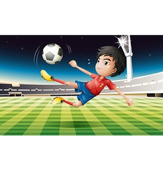 A young football player with a red uniform vector image vector image