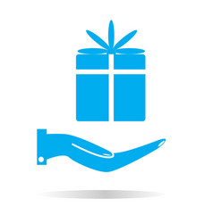 a gift in the hand icon hand and gift sign vector image