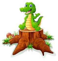 cute crocodile posing on tree stump vector image