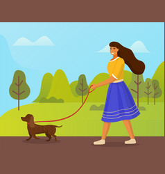 Girl in blue skirt is walking brown dog in green vector