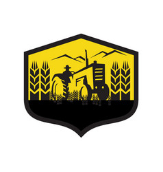Tractor harvesting wheat farm crest retro vector