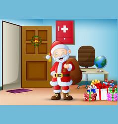 Santa claus brings a gift bag in workspace vector