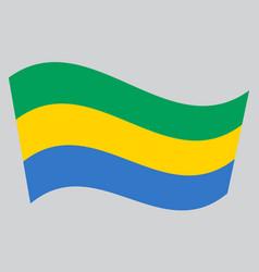 flag of gabon waving on gray background vector image