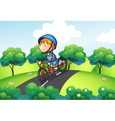 A boy riding in his bike vector image vector image