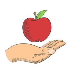 A hand with an apple vector