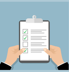 clipboard checklist in the hand hand holding vector image