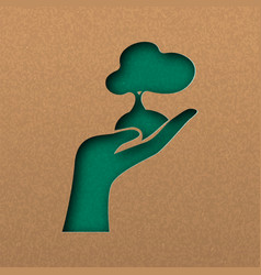 Green papercut nature concept hand with tree vector