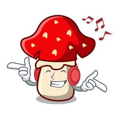 Listening music amanita mushroom mascot cartoon vector