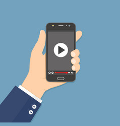 hand holding smartphone with video player on the vector image