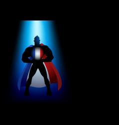 Silhouette a superhero under blue light vector