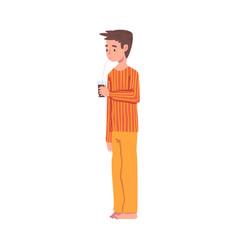 Slumber party cute boy in pajamas drinking soda vector