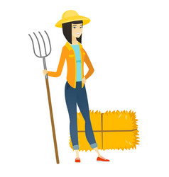 young asian farmer holding a pitchfork vector image