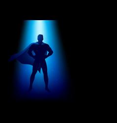 superhero standing under the blue light vector image