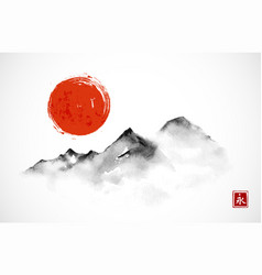 Mountains and red sun hand drawn with ink in vector
