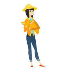 young asian farmer holding hay in hands vector image vector image