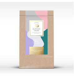Craft paper bag with almond chocolate label vector