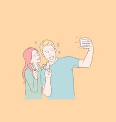 making selfie smiling couple victory gesture vector image