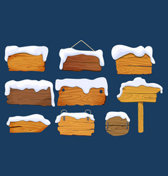 wooden signs boards with snow set different vector image