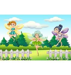 Three fairies flying in garden vector image vector image