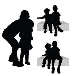 Children siting silhouette vector