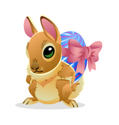 Easter bunny with the egg cartoon vector