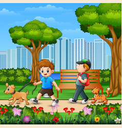 two boys walking with their dog in park city vector image