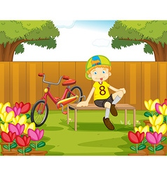 Boy and his bike in the garden vector