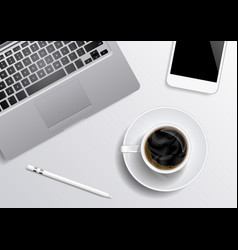 laptop smartphone coffee pen on the gray vector image
