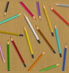scattered pencils on table background vector image vector image
