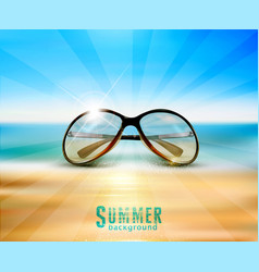 sunglasses lying on the beach in the sand on a vector image