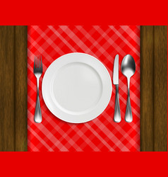plate fork spoon and knife on tablecloth vector image